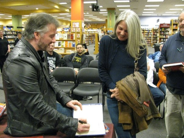 John Connolly signs Colby's book
